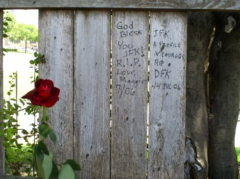 Notes and flowers left for President Kennedy on the Grassy Knoll Fence. Dallas, June 2008