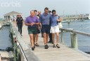 Kennedy Family Members Walk Along a Pier